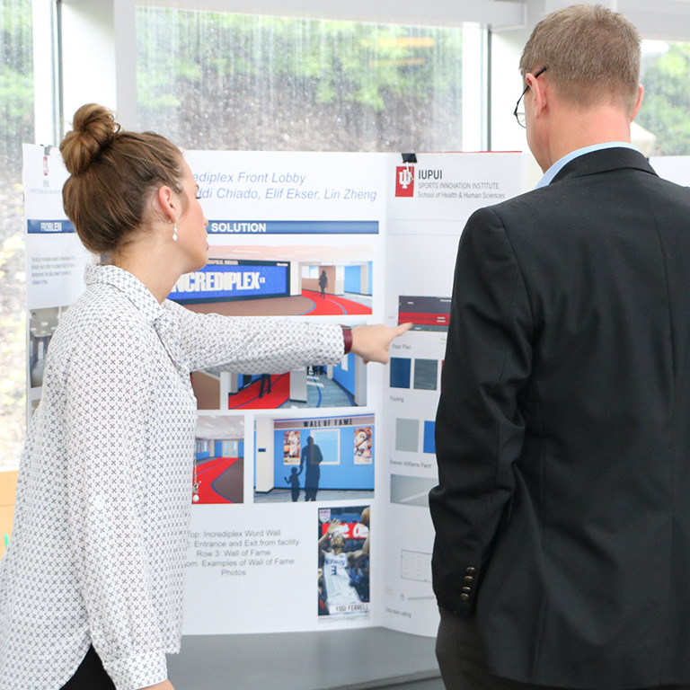 Sports Management student gives a presentation at TESM capstone showcase