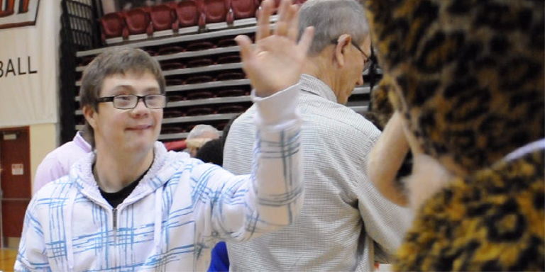 Program participant gives the IUPUI mascot a high five at one of the clinics.