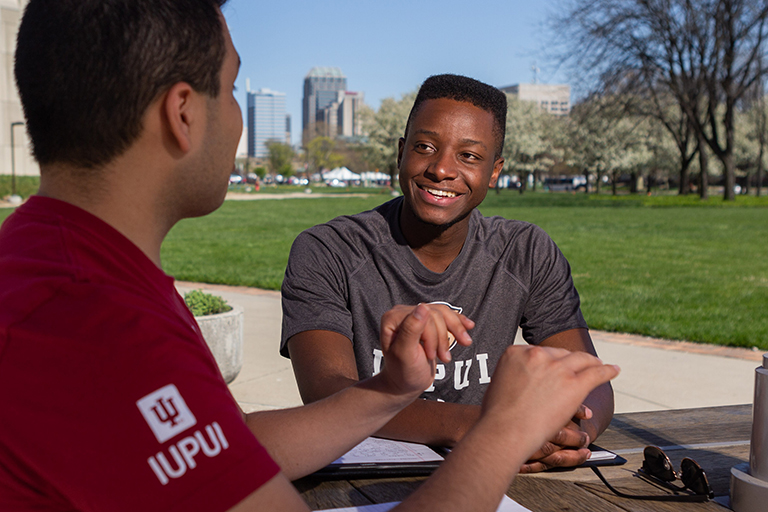 Two students hanging out on IUPUI's campus.